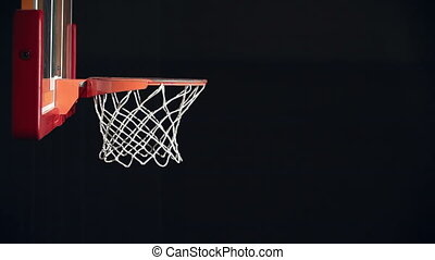 Jump Shot - Side view of basketball player scoring the...