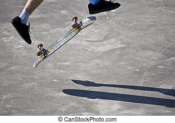Jump - skateboarder trying to do a jump with his board