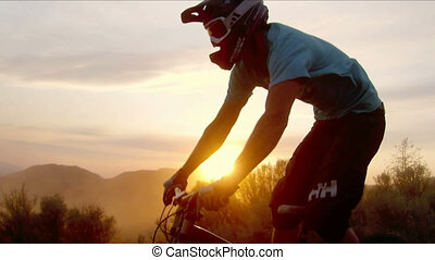 jump with a mountain bike and orange sunset.