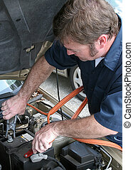 Jumper Cables 2 - A mechanic using jumper cables to start a ...