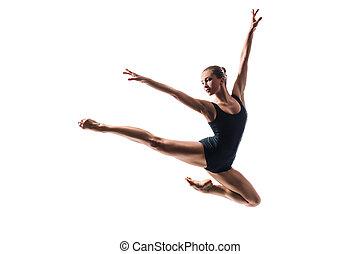jumping ballerina - beautiful ballet dancer posing on white...