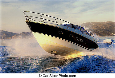 a motoryacht power jumping on a wave
