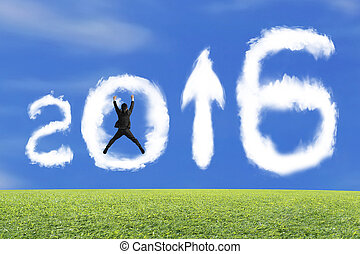 Jumping businessman cheering 2016 arrow up shape clouds with...