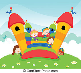 Group of kids playing on bouncy castle