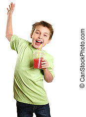 Jumping child holding healthy fruit juice - A boy jumps in...