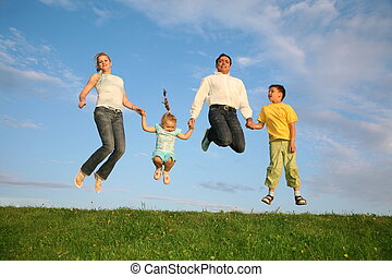jumping family grass sky