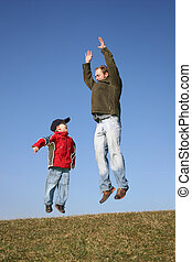 jumping father with son