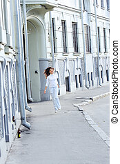 Jumping girl on street