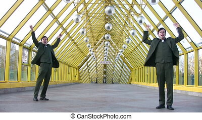 jumping happy two businessmen on bridge