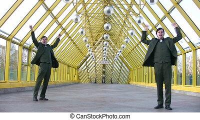jumping happy two businessmen on bridge