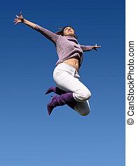 Jumping high - Young woman jumping high