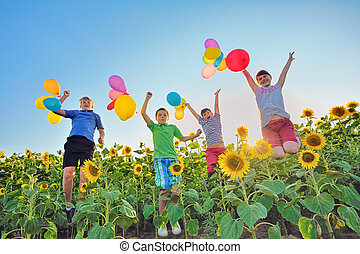 Jumping kids on field