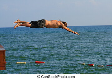 Jumping man - Man jumping into the sea