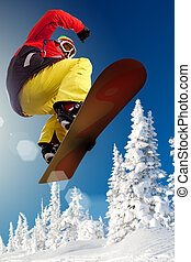 Jumping - Portrait of boy with snowboard jumping near snowy...