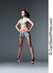 jumping sportswoman
