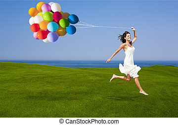 Jumping with a colored ballons