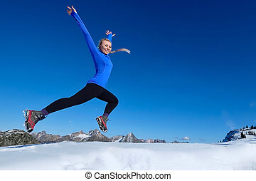 Jumping with joy. - Young pretty girl jumping in mountains....