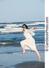 Jumping woman at sea