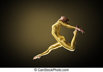Jumping Woman dance in golden Body Suit. Ballerina back bend Profile view. Dark background