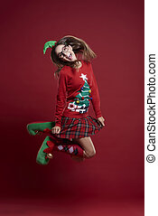 Jumping woman in Christmas clothes
