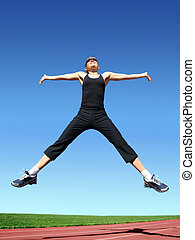 Jumping woman - Young woman exercising on a racetrack