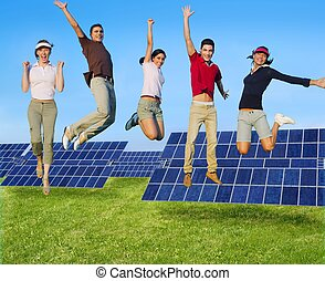 Jumping young people happy group green energy solar plates