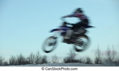 jumps on motorcycle side view low angle - flight jumps on...