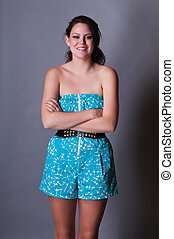 Jumpsuit - Tall young brunette in a skorts jumpsuit
