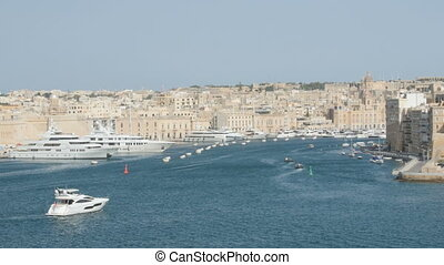 June 2016. Valletta, Malta. Boat floating in capital with...