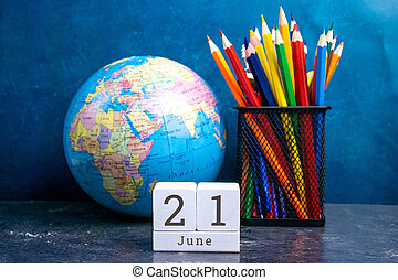 June 21 on the wooden calendar.The twenty-first day of the summer month, a calendar for the workplace. Summer