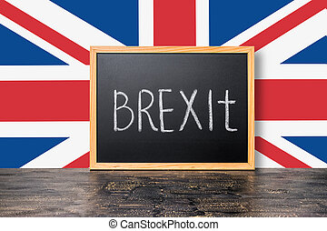June 23: Brexit UK EU referendum concept with flag and handwriting text written in chalkboard on black craquelure background, close up