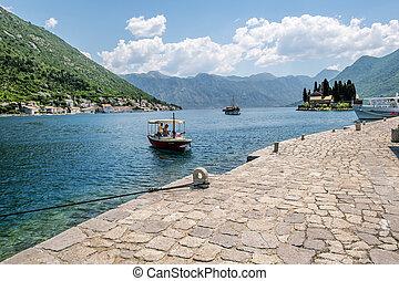 The boat pier on Church Island Gospa od Shkrpela in Kotor bay. Montenegro.