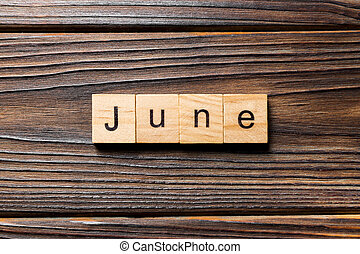 June word written on wood block. June text on wooden table for your desing, Top view concept