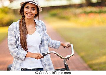 junge frau, fahrenden fahrrad, draußen