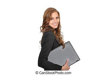 Junge Frau mit Laptop seitlich