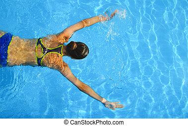 junge frau, schwimmender, in, a, blaues wasser, von, schwimmbad