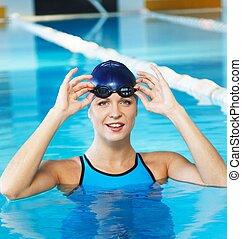 junge frau, tragen, blaues, schwimmen- klage, und, hut, in, schwimmbad