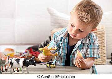 junge, wenig, spielende , spielzeuge