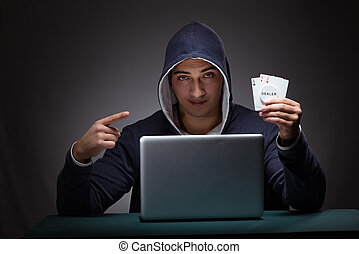 junger mann, tragen, a, hoodie, sitzen, vor, a, laptop-computer