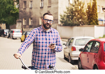 junger, poppig, mann, besitz, fahrrad, lenkstange, und, beweglich
