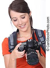 junger, weibliche , fotograf