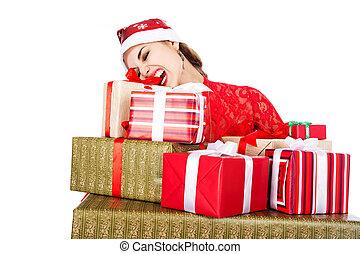 junges mädchen, in, santa, hüte, z�hne, schwierig, öffnen, a, kasten, mit, a, geschenk