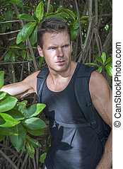 Jungle explorer - Handsome rugged muscular Caucasian man in ...