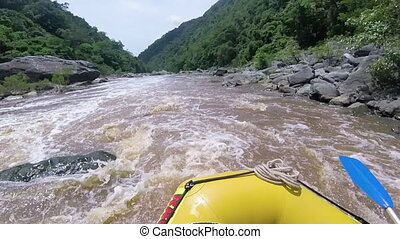 Jungle river with unstable current - A medium shot of a...