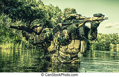 Jungle warfare unit - Pair of soldiers in action during...