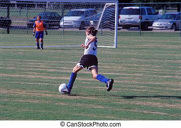 Junior girl soccer - Girl soccer player heading towards the...