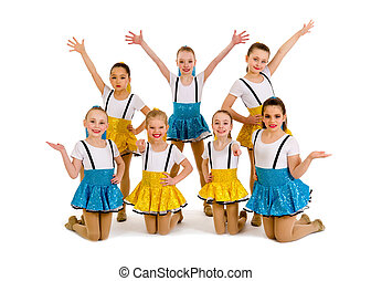 A group of junior jazz dancers in recital costume