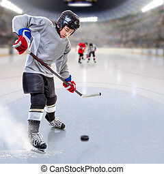 Junior Hockey Player Puck Handling in Arena - Junior ice...