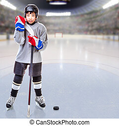 Junior Ice Hockey Player Posing in Arena - Junior ice hockey...