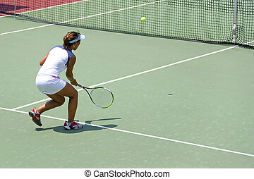 Junior Ladies Tennis - Junior ladies player in action at an ...